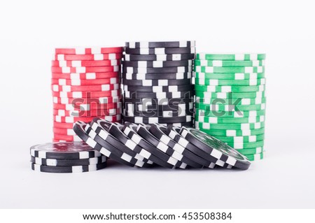 photo of Black, red and green casino chips isolated on white