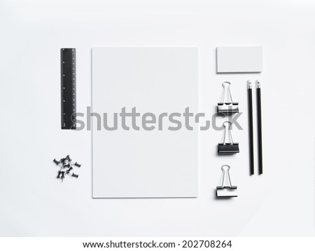 Photo of blank business cards letterheads with pencils isolated on white - stock photo