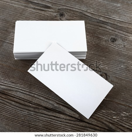 Photo of blank business cards on a wooden background. Template for branding identity. Top view. - stock photo