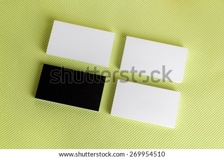 Photo of blank business cards on green background. Template for ID. Top view. - stock photo
