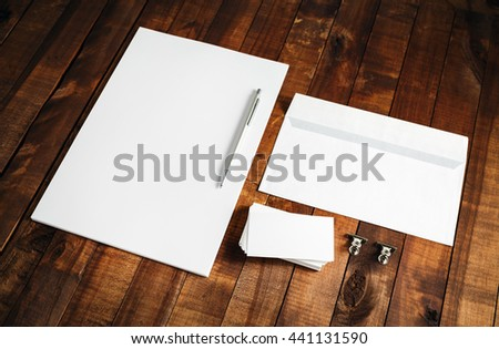Photo of blank letterhead, business cards, envelope and pen on vintage wooden background. Blank stationery and corporate identity template. Mock-up for branding identity. - stock photo