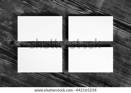 Photo of blank white business cards on wood table background.. Mock-up for branding identity for designers. Isolated with clipping path. Top view. - stock photo
