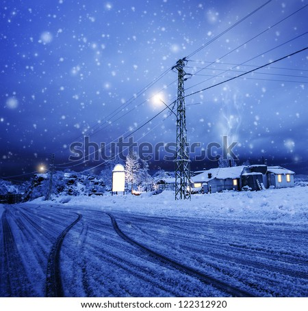 Photo of blizzard in the village, snow falling on the house, night wintertime landscape, Christmastime greeting card, winter holiday, luxury ski resort, cozy homes in Lebanon, Xmas vacation concept - stock photo