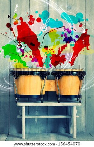 Photo of bongo drums with wooden background - stock photo