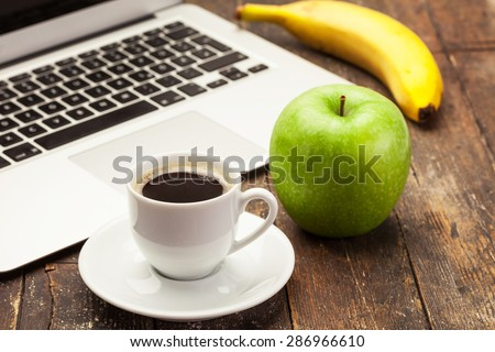 Photo of breakfast while working at computer - stock photo