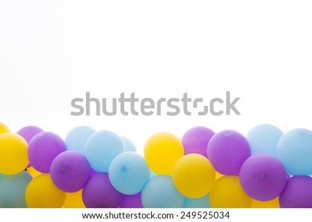 Photo of bright bunch of colorful balloons background - stock photo