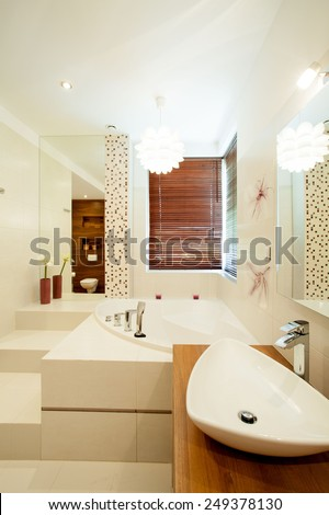 Photo of bright modern bathroom full of luxury
