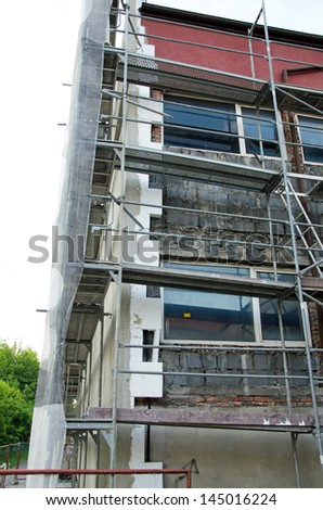 Photo of building being insolated with styrofoam - stock photo
