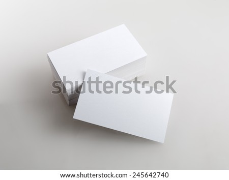 Photo of business cards. Template for branding identity.  Isolated with clipping path. - stock photo