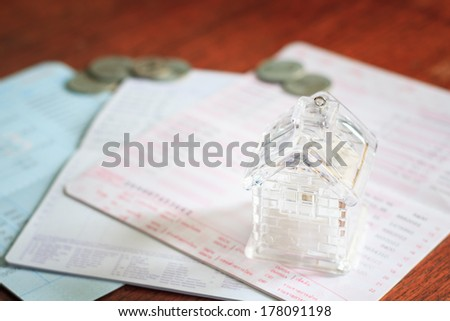 Photo of Business concept of home loan with book bank statement in vintage style - stock photo