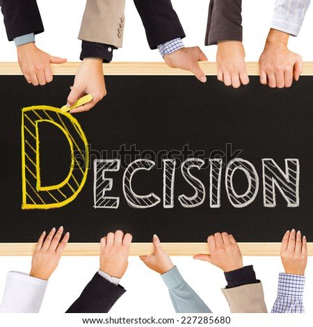 Photo of business hands holding blackboard and writing DECISION concept - stock photo