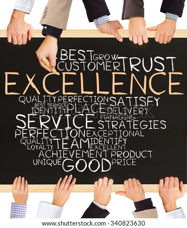 Photo of business hands holding blackboard and writing EXCELLENCE concept - stock photo