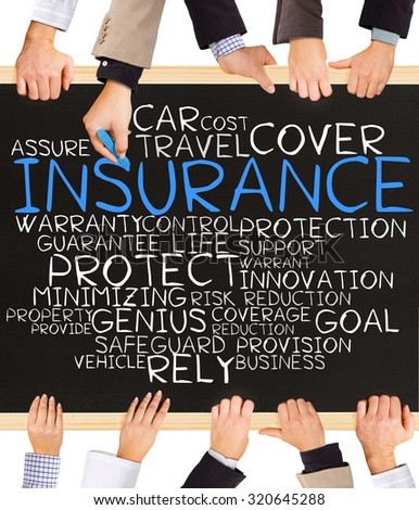 Photo of business hands holding blackboard and writing INSURANCE word cloud - stock photo
