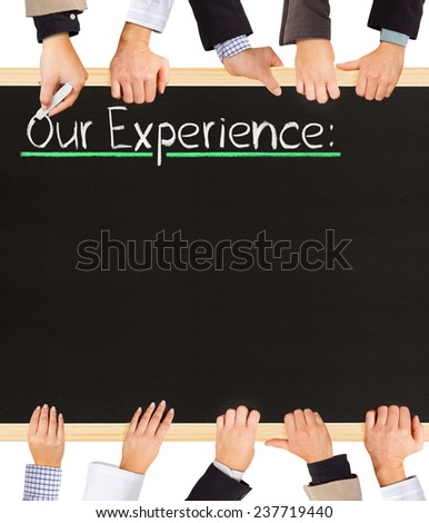 Photo of business hands holding blackboard and writing Our Experience - stock photo