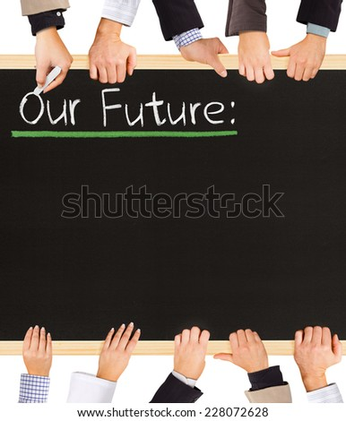 Photo of business hands holding blackboard and writing Our Future - stock photo