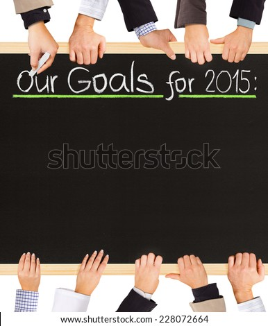 Photo of business hands holding blackboard and writing Our Goals for 2015 - stock photo