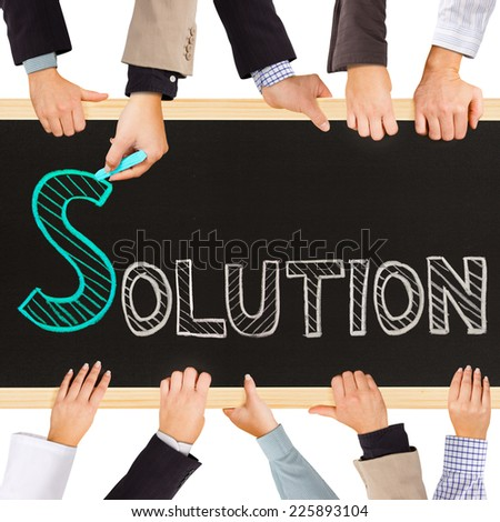 Photo of business hands holding blackboard and writing SOLUTION concept - stock photo