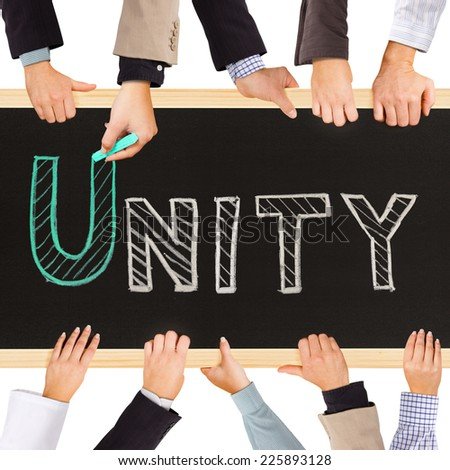 Photo of business hands holding blackboard and writing UNITY concept - stock photo