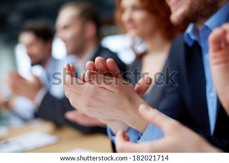 Photo of business partners�¢?? hands applauding at the meeting  - stock photo