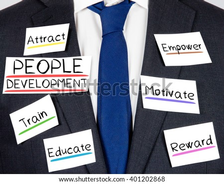 Photo of business suit and tie with PEOPLE DEVELOPMENT concept paper cards - stock photo
