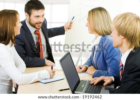Photo of businessman explaining a new project to partners - stock photo