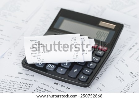 Photo Of Calculator On Generic Receipts With Costs - stock photo