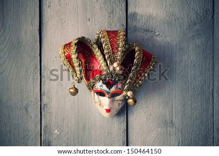 Photo of carnival mask on wooden background - stock photo