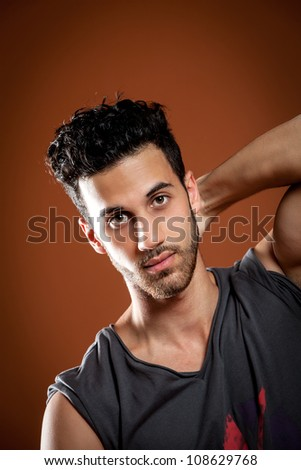 photo of casual attractive boy over background with vignette