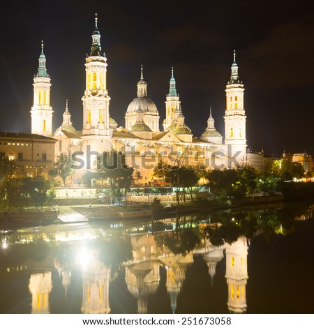 Photo of Cathedral and Ebro river in night. Zaragoza, Spain