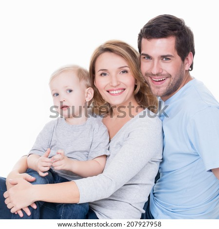 Photo of cheerful happy young parents with little child - isolated on white background.