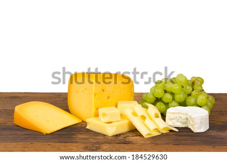 Photo of cheese and fruit on wooden board - stock photo