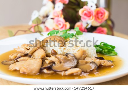 photo of Chicken and mushroom with sauce over rice