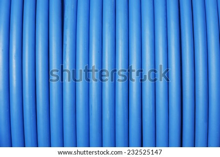 photo of close-up blue cable stored on reel