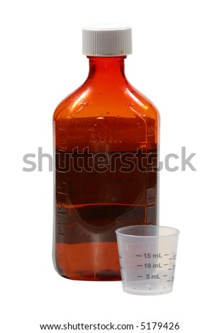 Photo of Cogh Medicine and Measuring Cup - Medical Related - stock photo