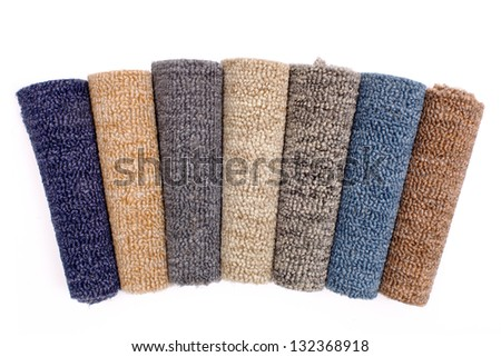 Photo of colorful carpet rolls - stock photo