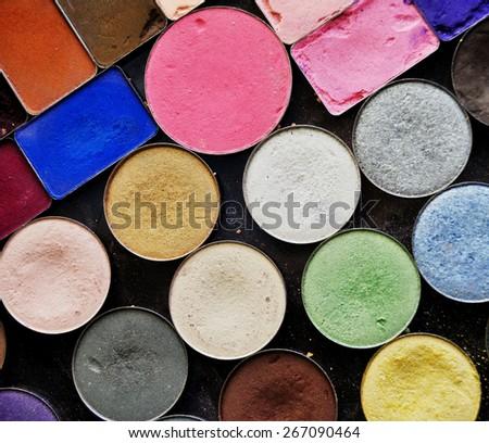 photo of colorful set of eyeshadows textured background - stock photo