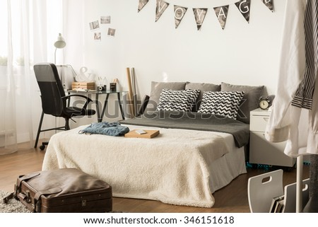 Photo of comfortable large bed in voyager room - stock photo