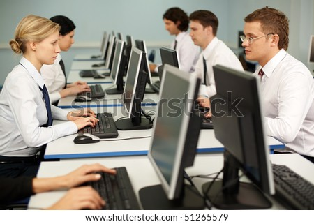 Photo of confident businesspeople doing some computer work