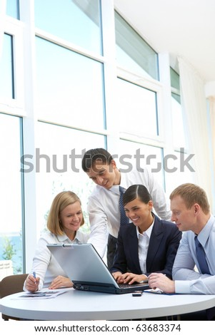 Photo of confident partners planning work at meeting in office - stock photo