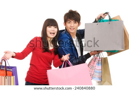 Photo of couple with shopping bags - stock photo