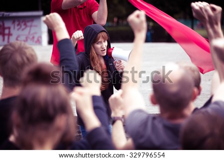 Photo of crowd protesting against government during social manifestation - stock photo