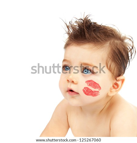Photo of cute baby boy with red kiss on the cheek, closeup portrait of nice child with blue eyes isolated on white background, Valentine day, happy childhood, pretty Cupid, love concept - stock photo