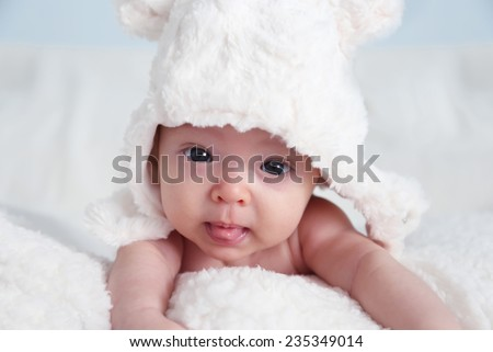 Photo of cute baby girl with white hat - stock photo