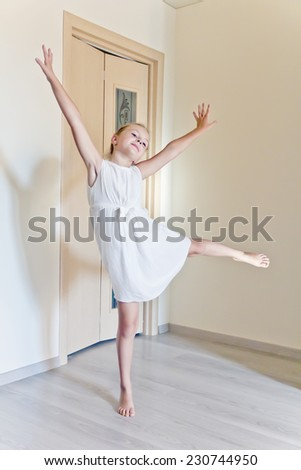Photo of cute dancing girl in white
