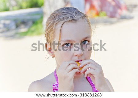 Photo of cute girl biting a meal