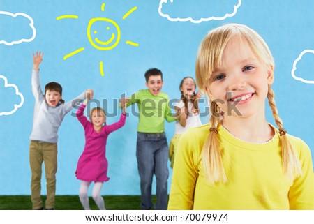 Photo of cute girl on the background of joyful friends - stock photo