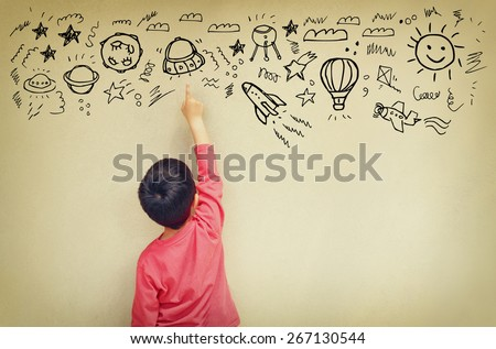Photo of cute kid imagine space ship fantasy. set of infographics over texured wall background  - stock photo