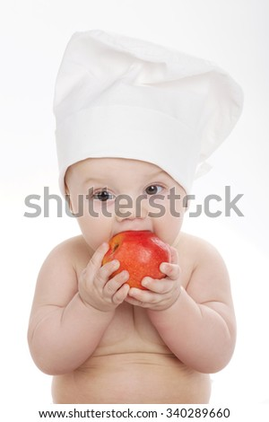 photo of cute little cook eating apple