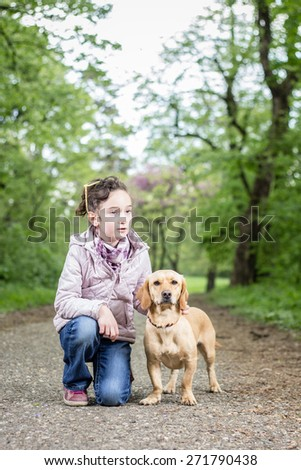 Photo of cute little girl with a dog - stock photo