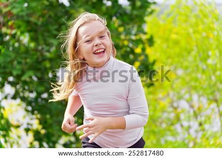 Photo of cute running girl in summer - stock photo